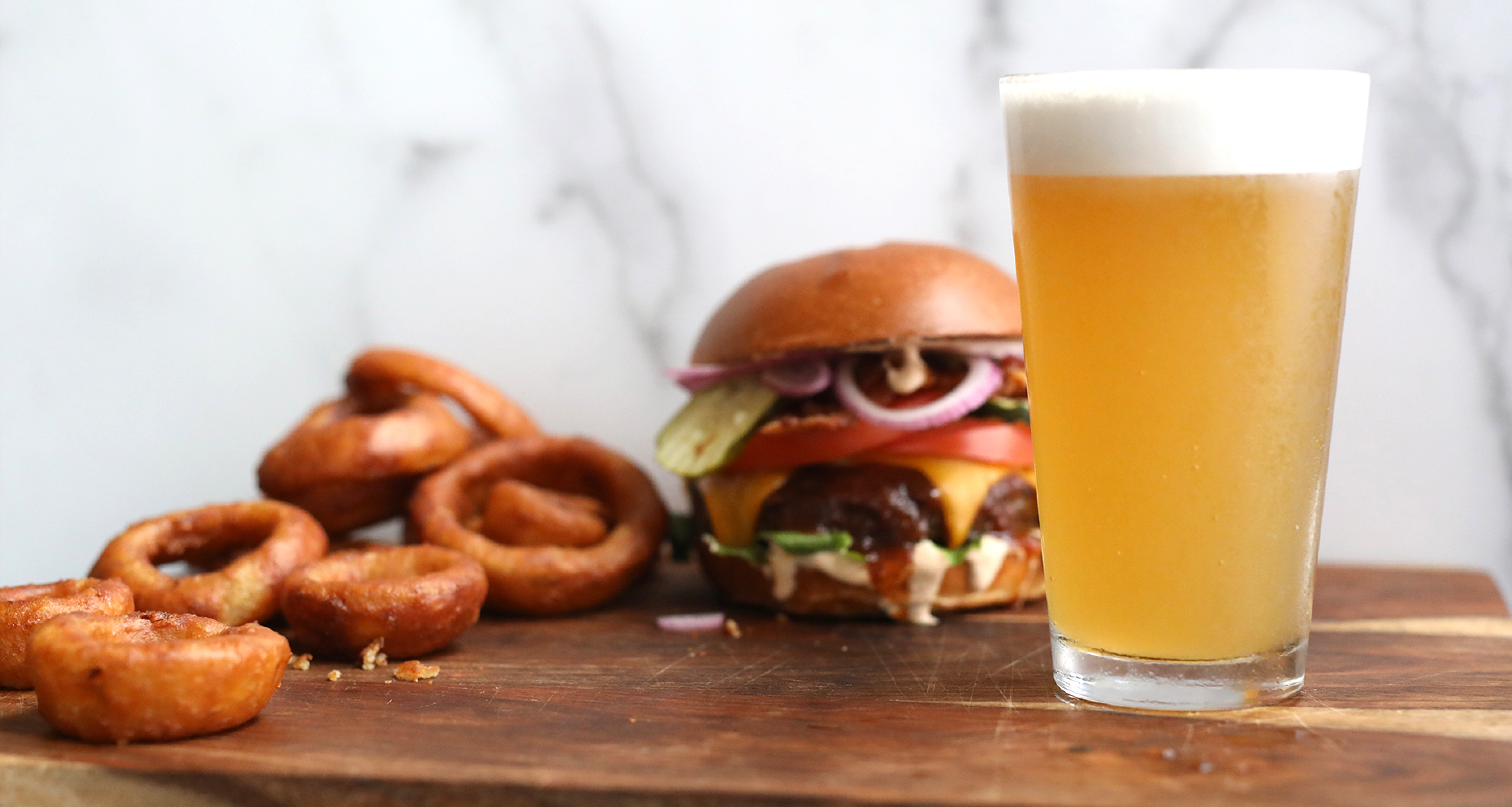 beer with onion and cheese burger