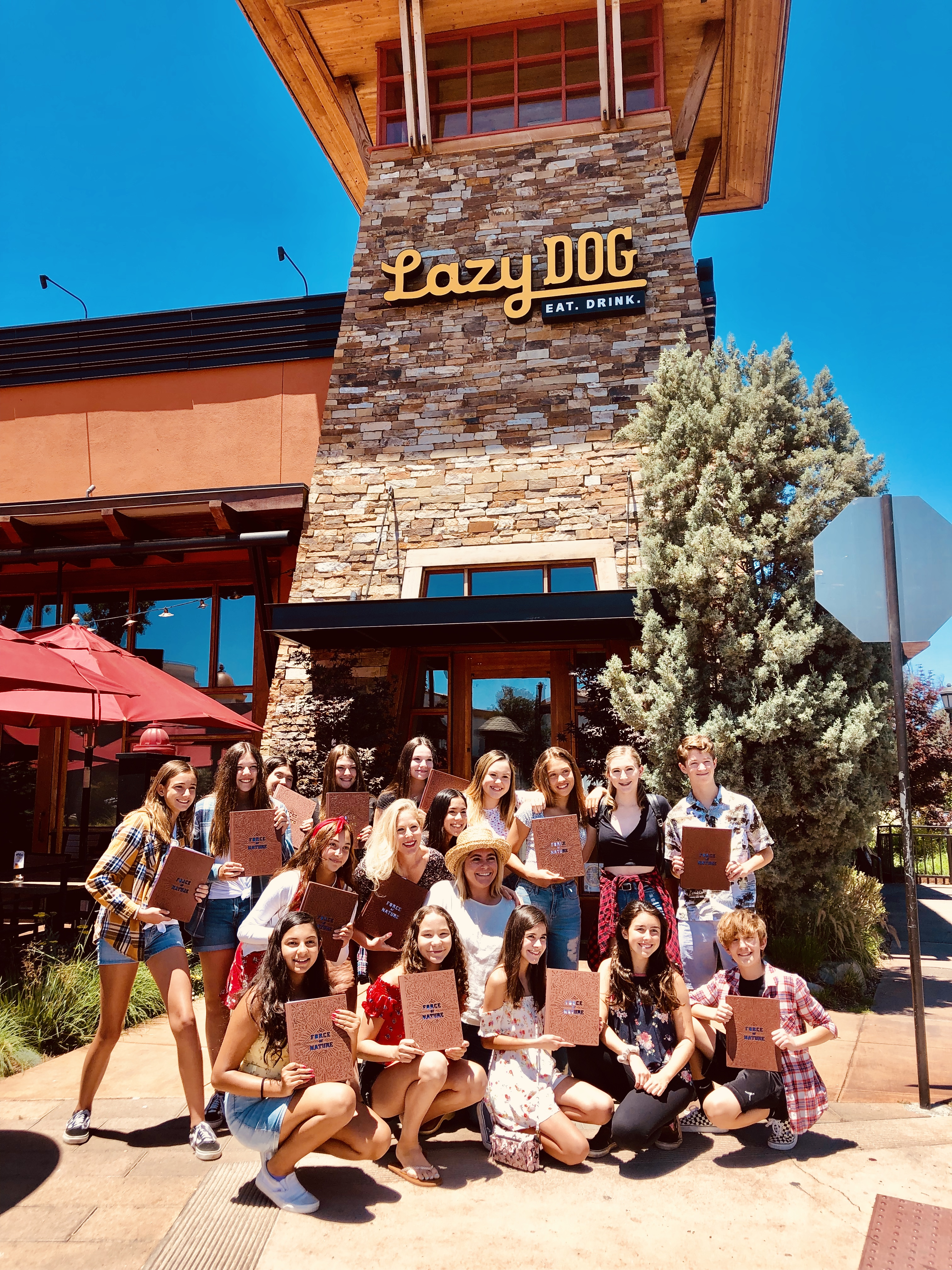 Outside picture of Lazy Dog with students