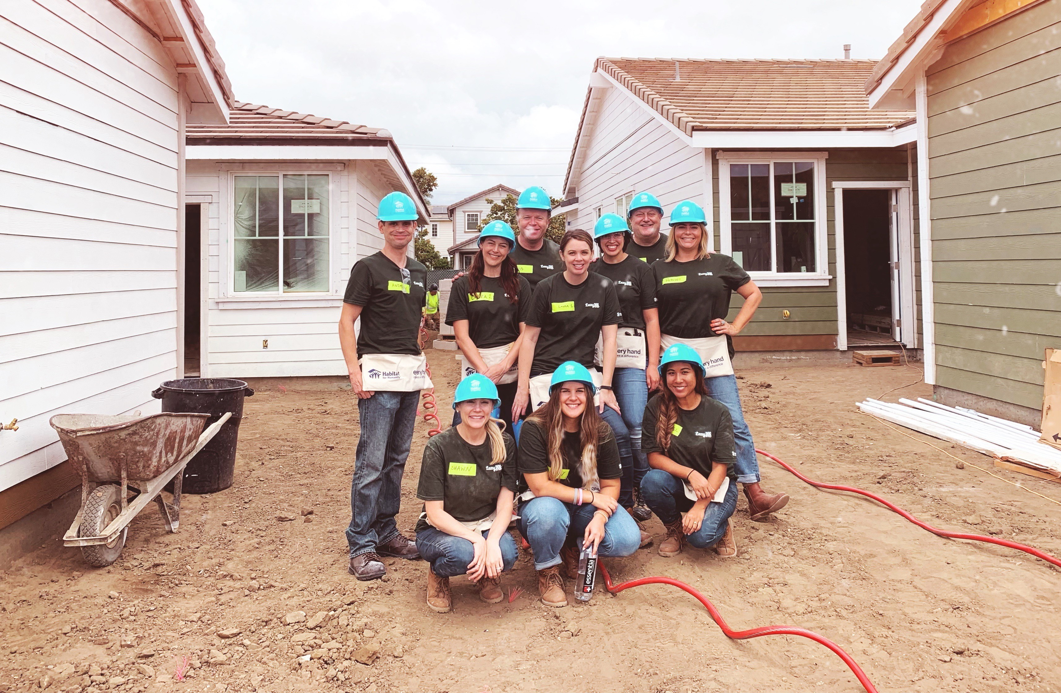 team in front of habitat for humanity build
